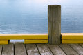 Wooden bollard on the dock sea pier designed for mooring ships Stock Photo