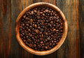 Wooden bowl with a coffee beans Royalty Free Stock Photo