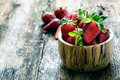 wooden bowl of fresh strawberries Royalty Free Stock Photo