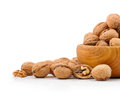 Wooden bowl full of walnuts on white background Stock Photo