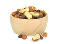 A wooden bowl of mixed fruit and nuts Stock Photography
