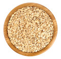 Wooden bowl with oats isolated on white background. Royalty Free Stock Photo