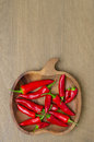 Wooden bowl with red chili peppers and space for text top view Royalty Free Stock Photo