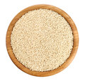 Wooden bowl with sesame seeds isolated on white background. Royalty Free Stock Photo