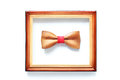 Wooden bowtie in wood frame isolated on white. Leadership, unique, independence, initiative, think different, success