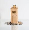 Wooden box Tzedakah, translating the text charity Royalty Free Stock Photo