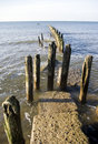 Wooden breakwater in sea Royalty Free Stock Photos