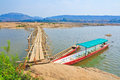 Wooden bridge across mekong river thailand Stock Photo
