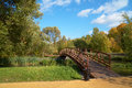 Wooden bridge across small river new chermyanka in moscow Royalty Free Stock Image