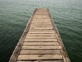 Wooden bridge from beach to the sea closeup old Stock Photos