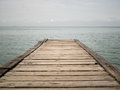 Wooden bridge from beach to the sea closeup old Royalty Free Stock Photography