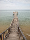 Wooden bridge from beach to the sea old Stock Photos