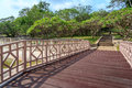 Wooden bridge crossing to park Royalty Free Stock Photography