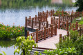 Wooden bridge on the lake Royalty Free Stock Photos