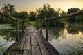 Wooden bridge on a lake at sunrise Stock Photos
