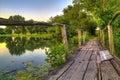 Wooden bridge on a lake at sunrise Royalty Free Stock Images