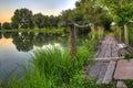 Wooden bridge on a lake at sunrise Royalty Free Stock Photo