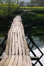 Wooden bridge this is leading to the village of Stock Photography