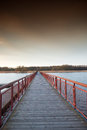 Wooden bridge over the lake at sunset Royalty Free Stock Images