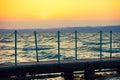 Wooden bridge over lake at sunset balaton Royalty Free Stock Photo
