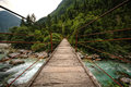 Wooden bridge over the mountain river hanging rope emerald soca slovenia Stock Photography