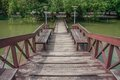 Wooden bridge over pond walkway on park of silpakorn university nakhonpathom Royalty Free Stock Photo
