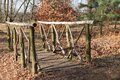 Wooden bridge a over a small woodland stream Royalty Free Stock Photo