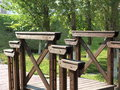 A wooden bridge in the park small leads over brook Royalty Free Stock Photo