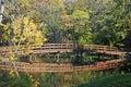 Wooden bridge and pound in autumn Royalty Free Stock Photo