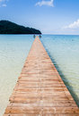 The wooden bridge and sea in holiday Royalty Free Stock Photo