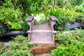 Wooden bridge and stream in garden Royalty Free Stock Photo