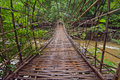 Wooden bridge tad pha souam southern laos Royalty Free Stock Image