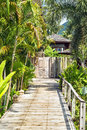Wooden bridge to the entrance to the villa of resort. Royalty Free Stock Photo