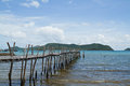Wooden bridge to the sea thailand Stock Photos