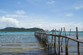 Wooden bridge to the sea thailand Stock Photo