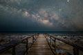 Wooden bridge walkway to the beach with milky way galaxy