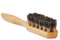 Wooden brush for cleaning shoes with the bristles on white background Royalty Free Stock Image