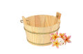 Wooden bucket with plumeria flower and sea shell isolated on white Stock Images