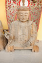 Wooden buddha statue a carved resting on the ground Royalty Free Stock Photos