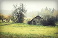 Wooden cabin in countryside scenic view of green with hazy background Royalty Free Stock Photography