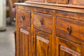 Wooden cabinet a closeup od a dark brown with drawers Stock Image
