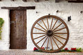 Wooden cartwheel and door in  andalusian patio Royalty Free Stock Photo