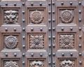 Wooden carved door close-up Stock Images