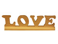 Wooden carved love the word out of wood Royalty Free Stock Images