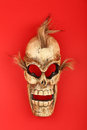 Wooden carved skull death mask on red Royalty Free Stock Photo
