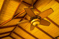 Wooden ceiling fan in classic tropical style Royalty Free Stock Photo