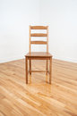 Wooden chair in the corner of a room Royalty Free Stock Photography