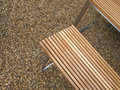 Wooden chair on the pebble floor Stock Photography