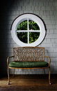 Wooden Chair and Round Window Royalty Free Stock Photo