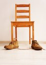 Wooden chair and shoes Royalty Free Stock Photo